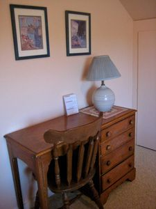 A large closet, dresser and desk and adjacent to the upstairs 3/4 bathroom/