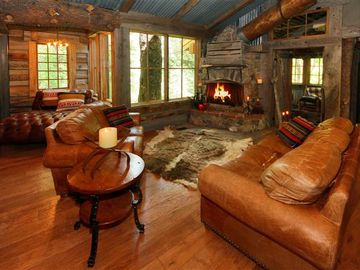 Native stone, wood-burning fireplace and ultra custom Sundance rustic design
