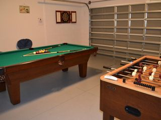 Legacy Park house photo - Games room with full size 8ft Olhausen Pool Table, Foosball Table, and Darts