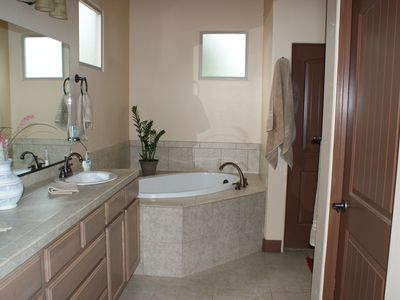 Master Bath with Jacuzzi Tub, walk-in shower and walk-in closet