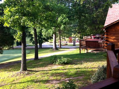 Branson cabin rental - Pool and playground within yards from cabin as seen from back deck