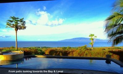 Launiupoko villa rental - pool area and spa. Notice the bay view down below and the island of Lanai.