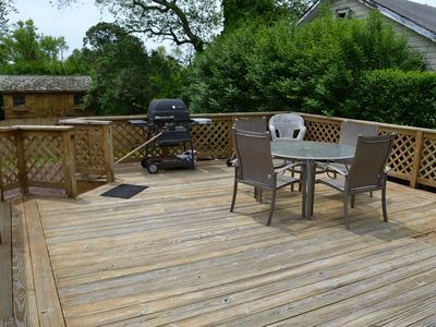 Huge back deck with grill and yard