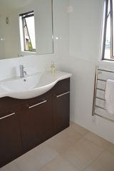 Auckland CBD townhome photo - Recently renovated upstairs bathroom with new tile and fixtures.