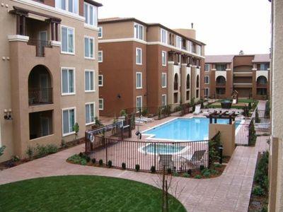 Modern condo in a newly built complex with pool and hot tub in a gated community