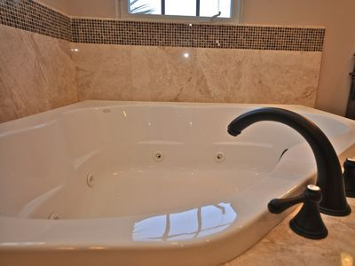 Relax in the private Jacuzzi tub and watch TV