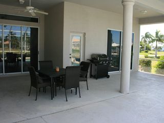 Vacation Homes in Marco Island house photo - Lots of Room on the Lanai for Outdoor Dining and Relaxing