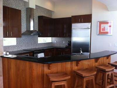Kitchen. Teak cabinets. Commercial appliances. Granite counter-tops