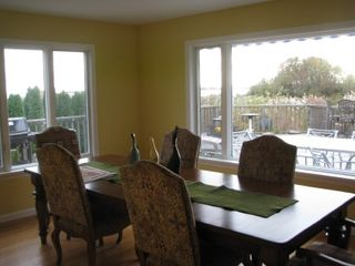 East Moriches house photo - Dining room attached to the kitchen. Big wrap around deck.