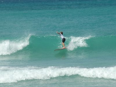 Surfing right in front of Apartment.(Surf varies with tides and season)