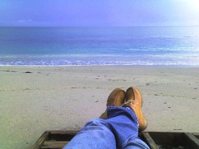 Relaxing on my beach after a long day at work. Gorgeous BLUE Atlantic water.