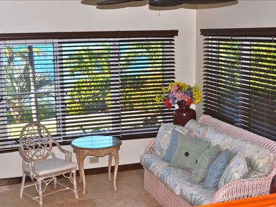 Sunroom located off kitchen provides sea breezes and clear blue water views