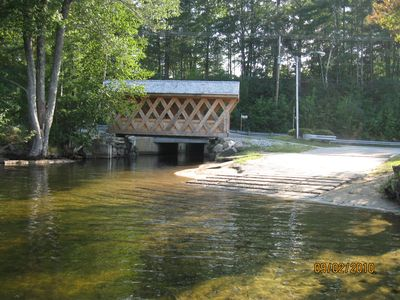 View of brand-new boat ramp with quaint covered bridge walkway.
