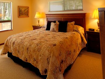 The master bedroom with king-size bed is on the upper level.