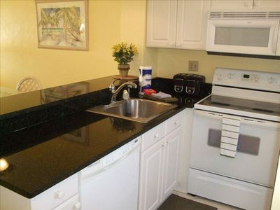New remodelled kitchen with granite counters and newer appliances