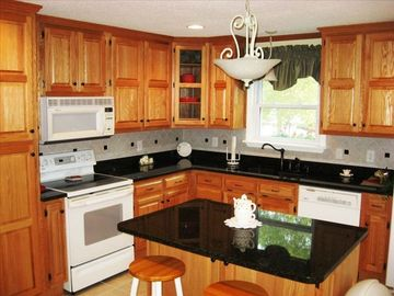 Kitchen with oak cabinets and granite counters