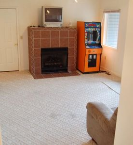 Lower level great room with gas fireplace, arcade, and adjoining King Master