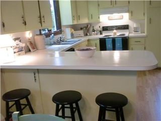 Pocasset house photo - another view of kitchen with four barstools