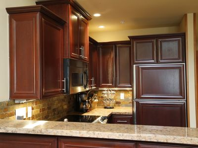 Stunning designer kitchen comes fully equipped including 10 sets of dishes.