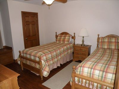 Lower level bedroom with two twin beds