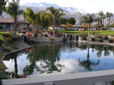 Palm Springs condo rental - Lakes/waterfalls across way with view of mountains in background