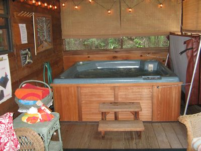 Large hot tub on our screened porch...rain or shine....always ready!