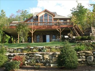 Lake Toxaway house photo - Large deck, covered parking, Jacuzzi, fire pit, professionally landscaped