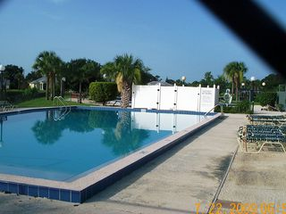 Vero Beach house photo - Children's pool at Clubhouse, Adult pool behind fence, overlook peaceful ponds.