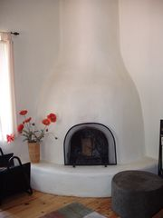 Taos house photo - Enjoy a cozy fire in the Kiva fireplace.