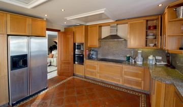 The large Kitchen adjoins the breakfast area and overlooks the pool.