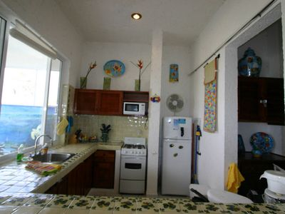 The Kitchen with FULL SIZE appliances has FAB views of the beach