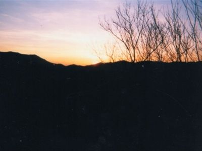 Winter sunset over Nantahala Range as seen from deck.