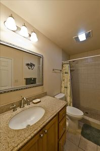 Granite Vanity with Custom Tile Walk In Shower
