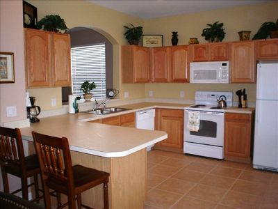 Kitchen with dishwasher, microwave, cook-top, oven, coffee maker, etc.