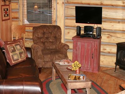 Laramie cabin rental - Living/sitting area off of the kitchen. TV, stereo, sofa sleeper.