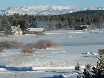 Pagosa Springs condo rental - View across the lake to the San Juan Mountains from front balcony and living rm