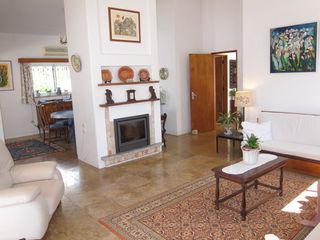 Casa da Figueira's nicely decorated living room with view to hallway & dining rm - Praia da Luz Area villa vacation rental photo