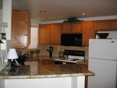 Beautiful kitchen with granite counters, new Bosch dishwasher, microwave.