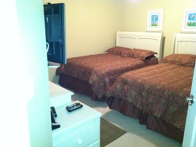 Two full beds in second bedroom with a flat screen TV and DVD player