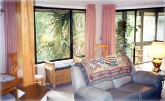 Large picture windows give natural light and beautiful views.