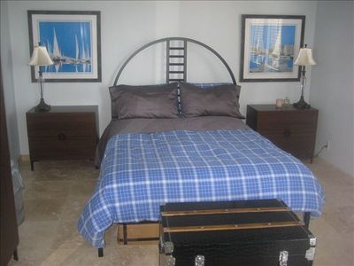 MASTER BEDROOM WITH OCEAN VIEW AND ACCESS TO BALCONY