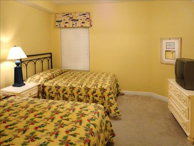 Large front bedroom with two full beds