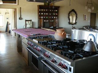 Taos house photo - Gourmet Kitchen with 2 Wolf Stoves -- 2 Large Ovens, 8 Burners and a Gas Grill