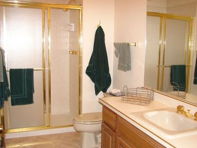 Large bath & shower accommodates the upstairs bedroom with 2 queen size beds.