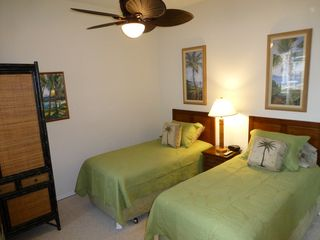 Waikoloa Beach Resort condo photo - 2nd Bedroom with 'Island Leaves' bedding on twin beds, tropical decor, Cable TV