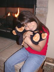 Ellijay cabin photo - Emily warming herself with Teddy by the fire place