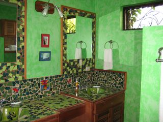 Nuevo Arenal house photo - Artfully designed bathroom.