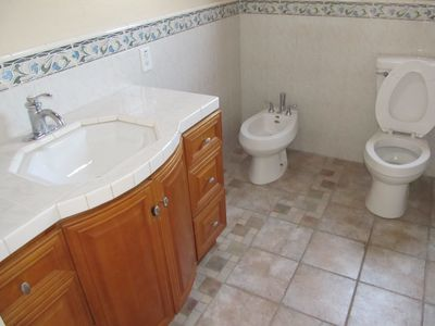 Master bath showing sink, bidet and toilet