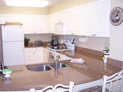 Kitchen is updated with granite counter tops and new appliances