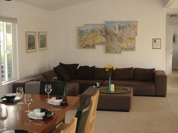 Sequoia Park house rental - Deer Park living room with original artwork showing Sequoia Park scenes